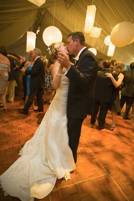 Paper lanterns over bride and groom on dance floor