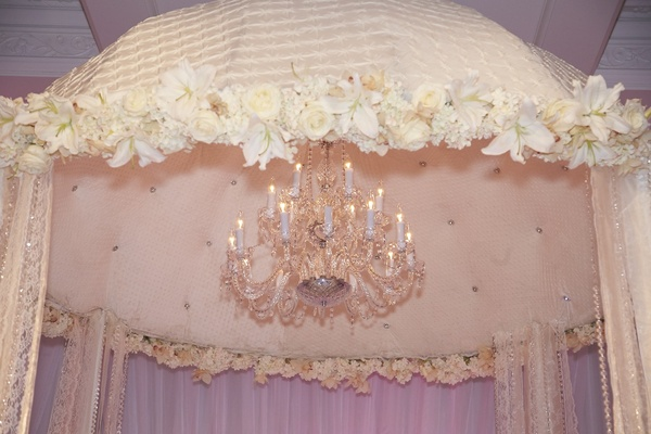 Crystal chandelier inside tufted velvet canopy