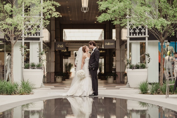 Wedding photo strapless wedding dress mermaid gown veil white bouquet groom in suit and bow tie