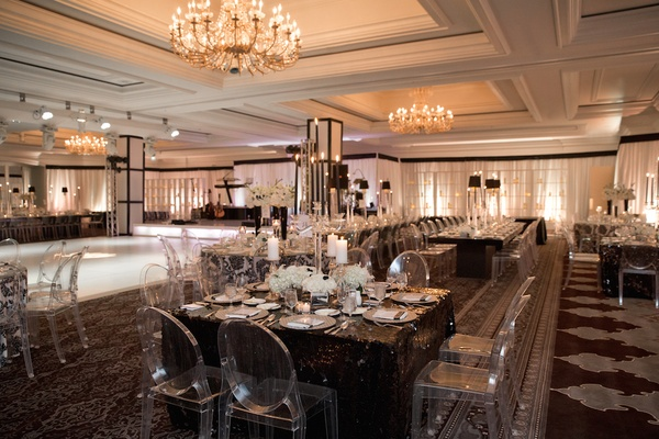 Snowy spring celebration in aspen colorado inside weddings ghost chairs around black tables and white dance floor couple in wedding solutioingenieria Images
