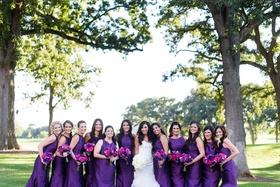 bride in monique lhuillier mermaid wedding dress, bridesmaids in eggplant monique lhuillier dresses