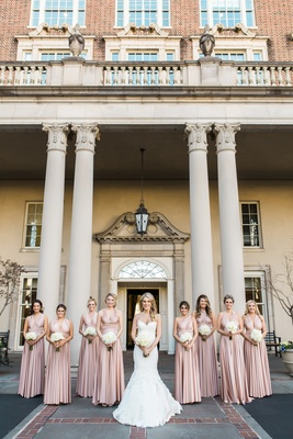 Bride in Ines Di Santo gown and bridesmaids stand together