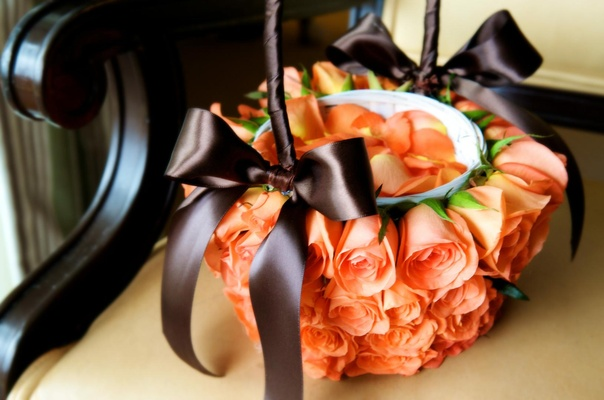 Apricot roses covering flower girl basket
