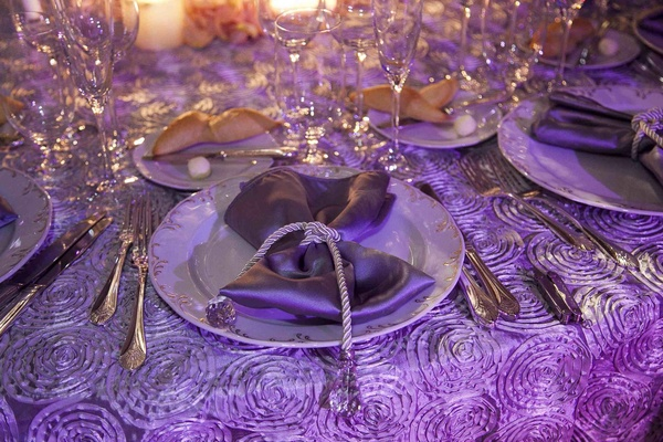Wedding place setting with rope and crystal around satin napkin