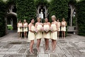 Bridesmaids in short bubble dresses with strappy heels