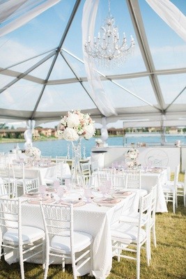tented reception by a country club pond, white linens, blush details
