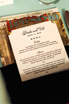 Wedding dinner menu in dark napkin on Little Nemo: Return to Slumberland comic book wedding favor