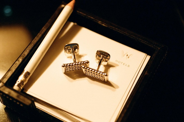 Groom cufflinks on W Hotel paper in hotel room