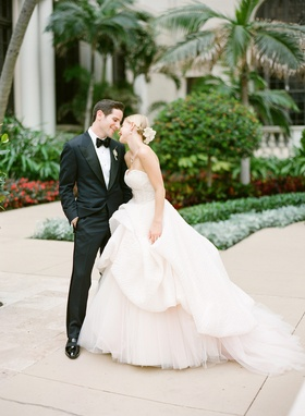 Man in fitted tuxedo and woman in princess ball gown
