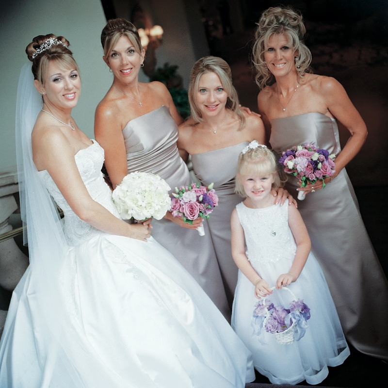 Bride with three bridesmaids and flower girl