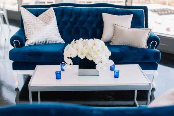 detriot lions quarterback matthew stafford rehearsal dinner decor blue white couch flowers candles