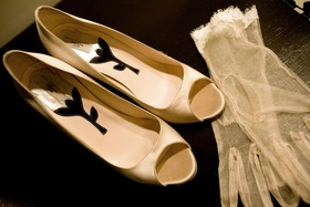 White satin heels with delicate lace gloves