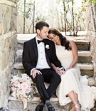 private moment between bride and groom before wedding ceremony black tuxedo white gown sheath dress