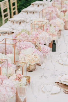 Wedding reception long centerpiece mini rose arrangements candle votives rose gold vessels geometric