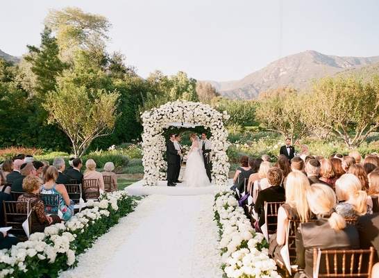 Bride and groom beneath chuppah at Santa Barbara wedding
