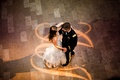 Bird's eye view of bride and groom dancing at wedding reception