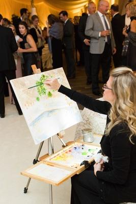 Live painter wedding reception painting on canvas of reception dance floor decor design