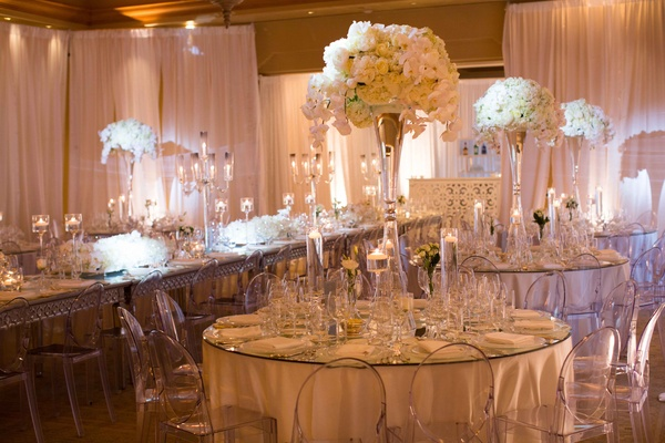 white reception concept clear elements glass vases tall florals long round tables pelican hill
