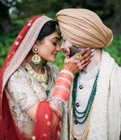 bride and groom indian sikh wedding portrait red veil and bangles groom traditional attire cultural