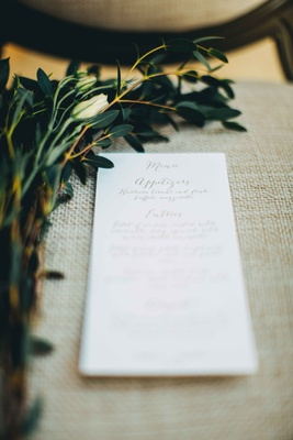 calligraphy dinner menu on chair branches white flower mexico destination wedding punta mita