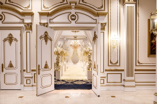 wedding ceremony decor visible through doorway of ballroom at the legacy castle in new jersey