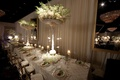 Tall centerpiece atop white and gold table