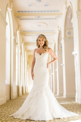 Bride in trumpet wedding dress by Ines Di Santo sweetheart neckline lace blonde hair down