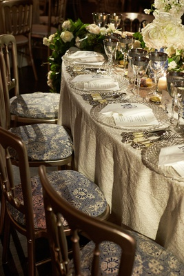 wedding reception luxe linens blue and white pattern chair cushions silver backs bone china silver