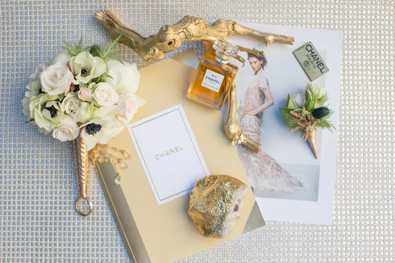 small white and gold bouquet with coco chanel items journal picture perfume branch emblem