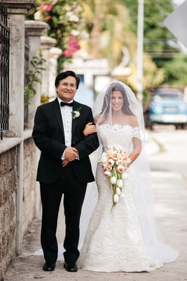Bride in an Anna Maier ~ Ulla-Maija fit-and-flare gown with lace jacket, mother's veil