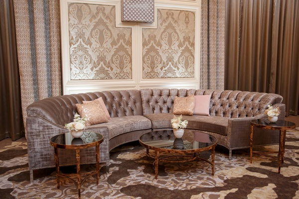 wedding reception curved semi circle sofa settee pink pillows gold tables lounge area damask print