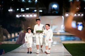 sundown wedding ceremony for jewish wedding three ring bearers in short suits with yarmulkes