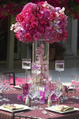 Floating candles and magenta floral arrangement