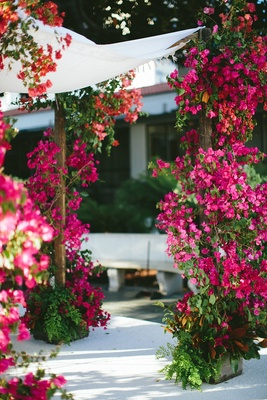 fuchsia flowers around chuppah pink bougainvillea arch