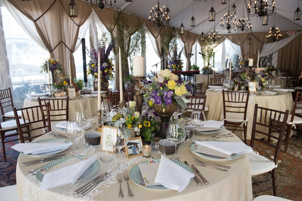 champagne hued circular tablescape centerpiece purple yellow chandeliers new york city skyline