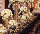 ivory flowers on gold stand with crystals, gold painted split leaves