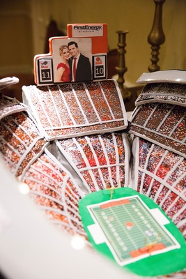 Cleveland Browns football stadium groom's cake with couple's engagement photo on jumbotron
