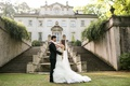 bride in allure couture trumpet gown with beading and ruffles, groom in tuxedo, estate
