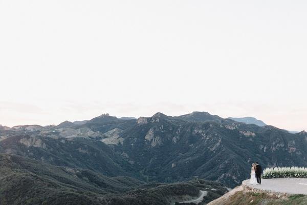 bride and groom look off at the santa monica mountains, malibu rocky oaks