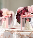 Small cakes in clear box tied with pink ribbon