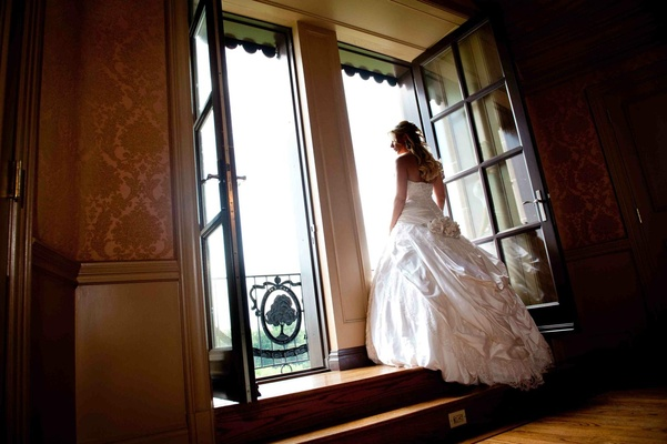 Bride shows the back of her Pnina Tornai ball gown