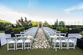 the london west hollywood rooftop ceremony, rose petals on aisle, white folding chairs