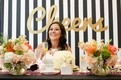 Bride with mimosa in a gold sugar rimmed champagne flute at bridal shower