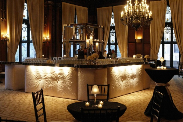 Cushioned walls and crystal chandelier