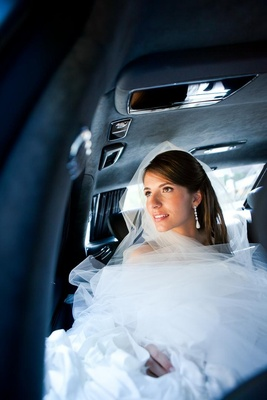 Wedding dress and bridal veil tucked in vehicle