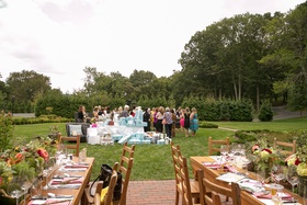 Wood tables in foreground and presents and guests in background