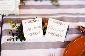 white place cards with gray type and scrolls