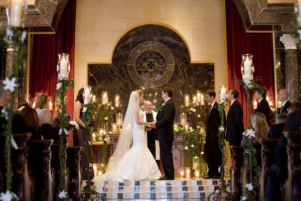 Church wedding illuminated by candlelight