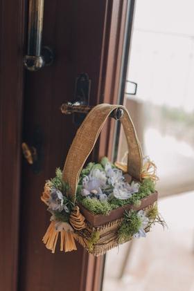 Wood basket with moss at Nick Carter's wedding