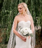 bride posing modified trumpet gown sweetheart neckline strapless lace beading veil portland wedding